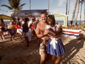 A tourist dances with local hospitality worker in the Dominican Republic