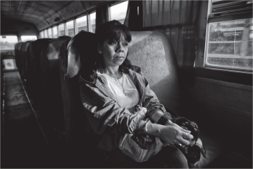 This picture depicts women's common return home after working in the maquiladoras, by bus with no protection. Here, Josefina Campa is pictured leaving her job after a day of working in the maquiladoras in Ciudad Juarez.