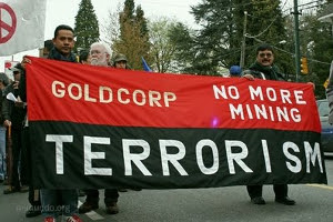 "Guatemalans protest Canadian mining company GoldCorp, urging their withdrawal because of the human rights violations it brought about, hence the slogan ""terrorism."""