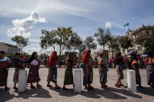 This image shows the many indigenous women getting together to protest against the mining operations, in order  to protect their land, culture, and community residents.
