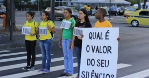Brazilian Salvation Army volunteers campaigning against human trafficking, within the context of the FIFA World Cup. Portuguese text reads: 'What is the value of your silence?' (Credit: Photo courtesy of IHQ Flickr).