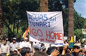 Protesters hold up a signing  demanding that the Bechtel subsidiary, Aguas del Tunari, cease its operations in Cochabamba.
